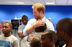 Harry is given a hug from one young boy named Relebohile 'Mutsu' Potsane, who threw his arms around him in a spontaneous gesture, before handing him presents including art, framed photos and hand-written letters