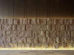 Upward linear cove for the stone textured wall Stone Cladding, Wall Cladding, Cove Lighting, Interior Lighting, Stone Wall Design, Architectural Lighting Design, Boundary Walls, Floor Ceiling, Interior Walls