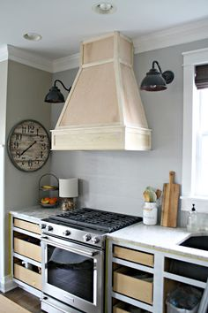 A DIY(ish) Wood Vent Hood | Thrifty Decor Chick Kitchen Vent Hood, Kitchen Stove, Kitchen Redo, Kitchen Exhaust Fan, Kitchen Cabinets, Kitchen Ideas, Wooden Kitchen, Kitchen Layout, White Cabinets