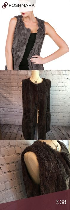 """Melody round neck faux fur vest. Melody carries high-quality faux fur with ultra soft feel of the fur. Melody is certified and specialized in making its own faux fur with entitled pattern in Korea. The quality and lifetime of Melody's clothes are trustable. Melody faux fur provides softness, coziness, and warmness in each product they produce.  Size M-L  bust 20"""" 32"""" from top of shoulder to bottom of vest. 2 pockets in front and 1 button at the top for closure excellent condition. Melody…"""
