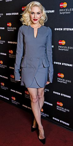 "Last Night's Look: Love It or Leave It? | GWEN STEFANI | So this is what it looks like when the fashion risk-taker tries her hand at ""business casual."" The navy dress and pointy toe heels that she wore to a Mastercard ""Priceless Surprise Performance"" announcement in L.A. seem uncharacteristically demure and girlie (do we spot a peplum?!)."