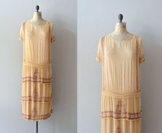 Vintage 1920s pale & sheer peach silk chiffon dress with wide neckline, short bead trimmed sleeves, long beading along each side of the dress, small