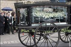 A Victorian hearse bearing the coffin of Isabella Blow,  a suitably stylish send-off for Isabella Blow