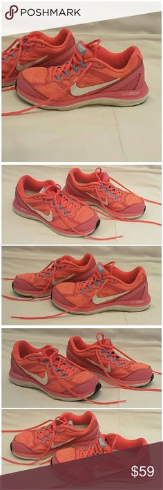 "40%BUNDLE DISCOUNT! FREE SHIPPING ON BUNDLES! NIKE DUAL FUSION, athletic shoes, size 6.5, Colorful! Shades of pinks. ADD TO A BUNDLE! 40%BUNDLE DISCOUNT! FREE SHIPPING ON BUNDLES! ""OFFER"" $6 LESS ON BUNDLE! Price firm unless Bundled. Only accepting ""offers"" of $6 Less on Bundles for shipping reimbursement. Nike Shoes Athletic Shoes"