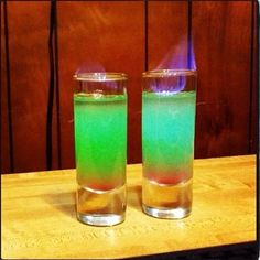 Smaug The Magnificent Shot  A flaming shot based on the dragon in The Hobbit. Hpnotiq Melon Liqueur Grenadine Goldschlager   Thanks @All for the dogs...