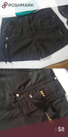 Jazzy Crystal & Stud cuffed shorts Very good condition. Casual with a little bling. Each stud has a rhinestone stud in it. Cute ribbon embellishment on pocket, 17 waist, 20 hip, 14 inches in length. Rayon/cotton blend. Machine wash White House Black Market Shorts