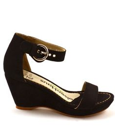 This sophisticated open-toed sandal by Olsen Haus is a comfortable and feminine wedge thats just the perfect height.