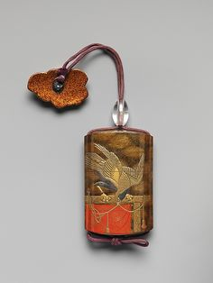 Case (Inrō) with Design of Two Hawks on Tasseled Perches  Period:     Edo period (1615–1868) Date:     19th century Culture:     Japan Medium:     Lacquer, roiro, mura nashiji, gold and coloured hiramakie, takamakie; Interior: nashiji and fundame