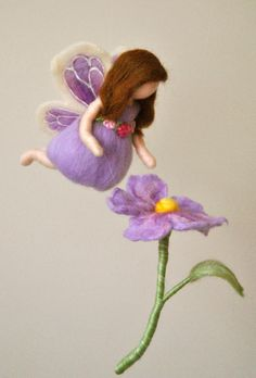 Waldorf inspired needle felted girl mobile: Butterfly  fairy with light purple flower by MagicWool on Etsy https://www.etsy.com/listing/120483180/waldorf-inspired-needle-felted-girl