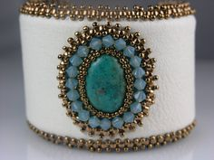 Beaded, Bead Embroidery, Statement White Leather Cuff with Turquoise. $129.00, via Etsy.