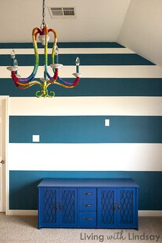 How to Tape and Paint Stripes on a Wall