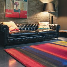 Kaleidoscope Stripe rugs are woven on axminster looms with a beautiful, multi coloured design. This wool pile is durable, soft to touch and hardwearing. #StripedRug #DesignerRugs #InteriorDesign