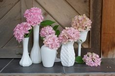 DIY Milk Glass.....Table centerpieces? Many different sizes with white,green,and purple flowers
