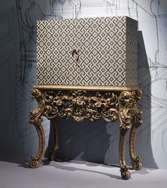 NEW BAROQUE COCKTAIL BAR ART 6710  A spectacular 'NEW BAROQUE' cocktail cabinet bar. This rare cocktail cabinet is upholstered in fabric with the stand of the cabinet in hand finished and carved antique gold.