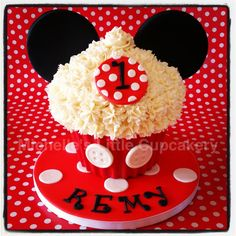 Mickey Mouse themed giant cupcake.