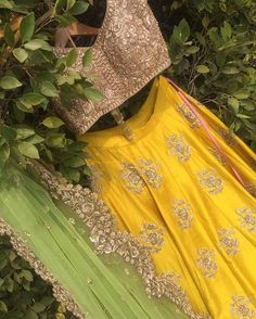 A fun session of candid photography fearing our lehenga tucked into a tree! by anamikpg Yellow Lehenga, Red Lehenga, Lehenga Choli, Sarees, Anarkali Dress, Anarkali Suits, Indian Wedding Outfits, Bridal Outfits, Indian Outfits