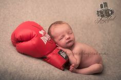 Newborn with boxing glove. Www.amplifiedwales.co.uk