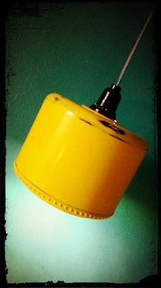 Super nice upcycled yellow motor housing into a pendant light!