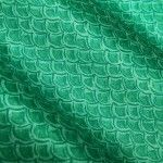 Island Safari Fabric in Seafoam Green is a scale printed discounted fabric in a bright green-teal hue, perfect for upholstering projects. This happy fabric is sure to add cheer to your home and works wonderfully for tropical/beach themed interior designs. Reminiscent of a mermaid's tail!