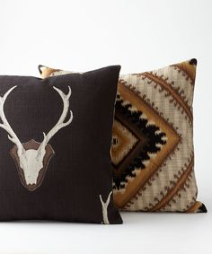 All Montana Pillows Montana Pillows: Two handsome pillows - a deer pillow with black background and diamond southwestern pillow in shades of brown. Rustic Elegance.