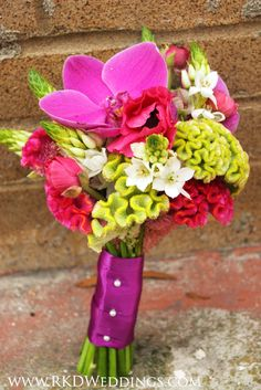 Love this bouquet of green Coxcomb Celosia, magenta Coxcomb Celosia, magenta/hot pink Anemones, white Star of Bethlehem and purple Phaleanopsis Orchid blooms!