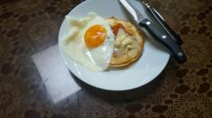 Pancake with soft cheese, slice of jelly jam and fried egg