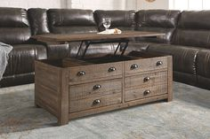 Grayish Brown Keeblen Lift Top Coffee Table from Ashley Furniture HomeStore