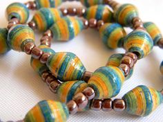 Support Fair trade, a great cause & women entrepreneurs & community Development!   Paper Bead Necklace from Bead Amigas