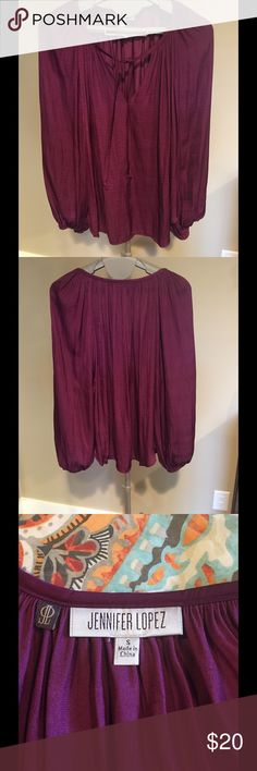 Jennifer Lopez Beautiful Tunic Top J Lo beautiful Tunic style top. This top has never been worn and is in new condition without tags. Jennifer Lopez Tops Tunics