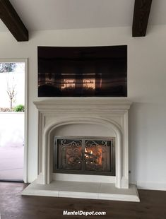 Cast stone mantel with iron door from Mantel Depot. Modern Fireplace Mantels, Stone Mantel, Fireplace Doors, Traditional Fireplace, Fireplace Surrounds, Fireplace Design, Fireplace Ideas, 1930s Fireplace, Mantles