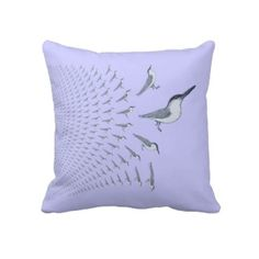 Terns In Flight Flying East On A Throw Pillow. This American Mojo pillow features a group of common terns in a spreading pattern on the pillow fabric against a pale blue background. There's a matching pillow with terns flying West. The background color can be changed.