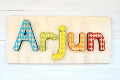 Personalised Name Jigsaw with option of personalised message on the back, $28 (free shipping within Australia).  www.notinshops.com.au  #notinshops.com.au #jigsaw #personalisedgift #childsgift #nurserydecor #nursery #chidsroomdecor #firstbirthday #personalised