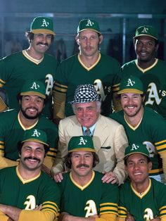 Athletics owner Charlie Finley poses with players (clockwise from top left) Rollie Fingers (34), Joe Rudi (26), Vida Blue (14), Gene Tenace (18), Bert Campaneris (19), Jim Catfish Hunter (27), Sal Bando (6), and Reggie Jackson (9) during a 1974 SI photo shoot. The team would win the World Series a couple months later. Can this year's squad bring another championship to Oakland? (Neil Leifer/SI)