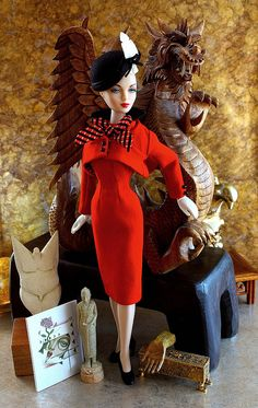 Miss Gene Marshall is luscious in red wool. Smart Set ensemble, designed by Doug James, is circa 1948.