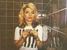 Vintage 1970's photo of Debbie Harry posing in the black bar stripes tee.