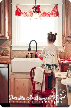 Helpin' momma ~K~ This is exactly how I washed dinner dishes starting about this same age ! How many children do this today...