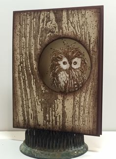 Featuring Impression Obsession's Feathery Owl SKU 726915 available from www.addictedtorubberstamps.com, wood grain embossing folder and circle die. Card created by Christine Yoerger.