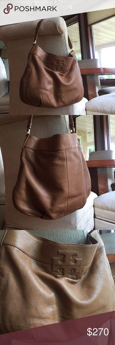 Tory Burch Stacked T Shoulder Bag NWOT NWOT gorgeous tan buttery leather. Gold polished hardware. TB designer fabric inside w/ large zipper makeup compartment, 2 separate sunglasses/cell pouches. TB storage bag included. Tory Burch Bags Hobos