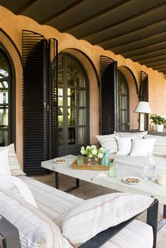 love this! Great french doors with shutters. the perfect outdoor space to entertain or read a book.