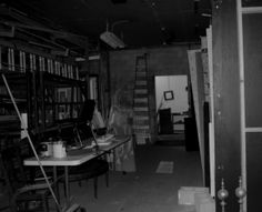 "A reader writes: ""I've attached a photo of what might be a ghost (in costume?) in the workshop area of an Oklahoma community theater. There are many reports that the theater is haunted: hearing footsteps, hearing one's name called, seeing people in the corner of one's eye — but, of course, no one is there. We also have many 'orb' photos, but this photo is probably the oddest piece of evidence we have."""