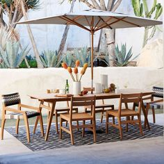 Outdoor dining gets an upgrade. With its richly-grained wood, angled legs and slanted back, the Mid-Century Dining Table spreads 50s and 60s style to your deck or patio. Teak is naturally moisture resistant and develops a beautiful silvery patina as it's exposed to sun and rain.