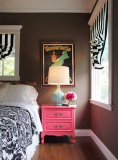 I like it when a bold pop of flamboyant color can be worked into a room without seeming childish. This pink nightstand works...
