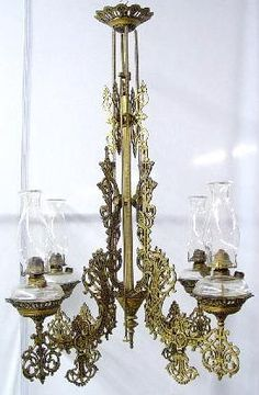 Victorian Cast Iron Chandelier With Four Arms And Clear Kerosene Fonts And Chimneys, Gold And Black Paint - American   c.1880-1900  -  Prices4Antiques