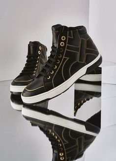 Ferragamo men's black leather sneakers with gold detail. www.Ferragamo.com #ManStory