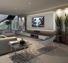 Sala em cinza e branco com tv na parede