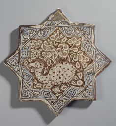 Tile (Изразец) | Place of creation: Iran | Material: faience | Technique: painted with lustre and cobalt blue | Date: Second half of the 13th century; Hermitage, St Petersburg