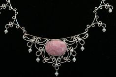 Google Image Result for http://www.northcountyoutlook.com/static/images/communities/2011-02-23_jewelry_featured_at_annual_rock_show/necklace.jpg