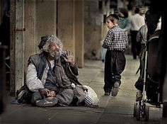 beggar begging on the streets of Jerusalem