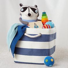 It's a boy! Our official baby gift bag includes a range of infant-safe goodies that will grow with the new arrival. What's more, mom gets a handy Stripes Around the Cube Bin out of the deal.