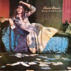 David Bowie, The Man Who Sold the World album cover, 1970 David Bowie altered his persona and appearance all through his career. He played on his androgynous looks in this shot - wearing a dress with long flowing hair Lp Cover, Vinyl Cover, Cover Art, Jonathan Rhys Meyers, Ziggy Stardust, David Bowie Album Covers, Rock And Roll, France Tv, Mick Ronson
